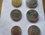 Mencoba menyandingkan pecahan logam kepingan uang Indonesia danMalaysia